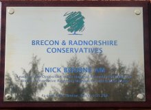 chemically etched brass plaque infilled 2 colours mounted onto dark stain solid mahogany wood backboard
