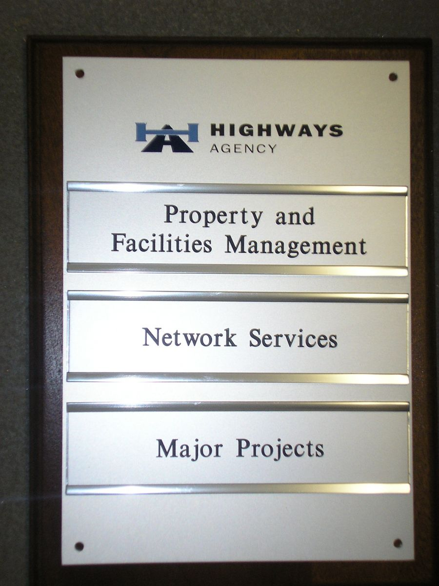 engraved aluminium signs - plaques with HIGHWAYS AGENCY logo infilled relevant corporate colours along with slider system to enable plates to be changed