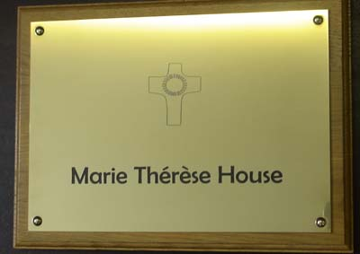 engraved polished brass plaque infilled black mounted onto medium stain solid oak plinth