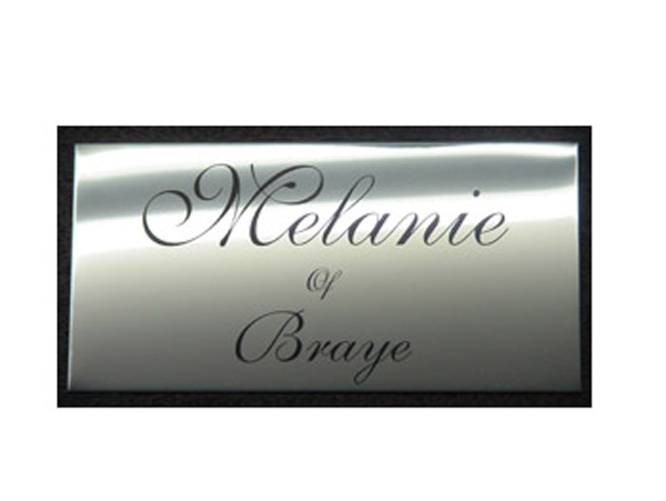 polished stainless steel plaque etched and infilled black