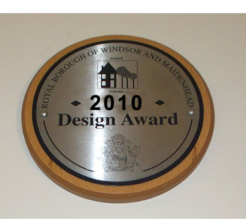 award plaque etched stainless disc infilled black mounted onto solid oak plinth