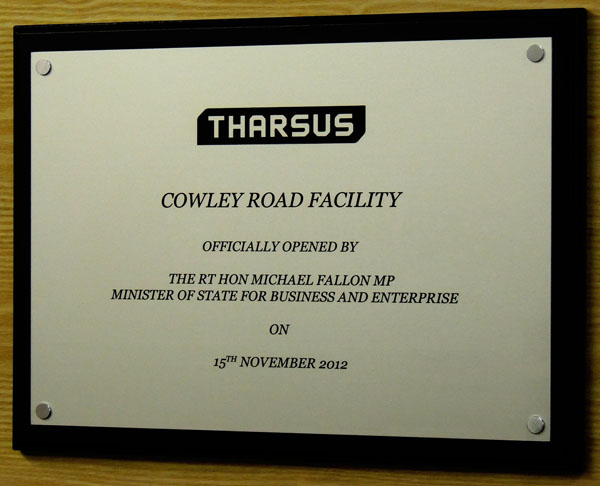 engraved aluminium plaque with corporate logo from a vector eps