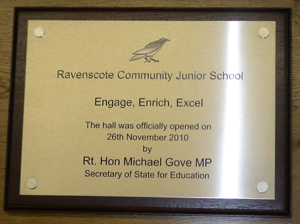 opened by plaque in brushed stainless steel